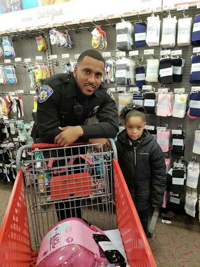 Alton Police Department probationary patrol officer Shawn Middlebrook shops with a young Alton School District student Saturday during the Police Benevolent and Protective Association (PB&PA) Alton Unit 14's annual Shop With A Cop outreach event. Photo: For The Telegraph