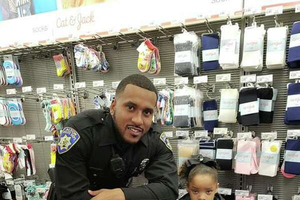 Alton Police Department probationary patrol officer Shawn Middlebrook shops with a young Alton School District student Saturday during the Police Benevolent and Protective Association (PB&PA) Alton Unit 14's annual Shop With A Cop outreach event.
