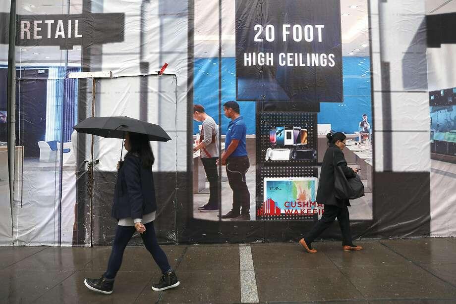 Pedestrians walk in the rain on Geary St. on Tuesday, Nov. 27, 2018, in San Francisco, Calif. Photo: Liz Hafalia / The Chronicle