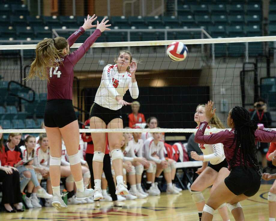 Amanda Meuth (15) of Katy attempts a kill shot in the first set of a Class 6A - III Regional Quarterfinal playoff volleyball match between the Cinco Ranch Cougars and the Katy Tigers on Nov. 5 at the Leonard Merrell Center in Katy. Photo: Craig Moseley, Staff / Staff Photographer / ©2018 Houston Chronicle