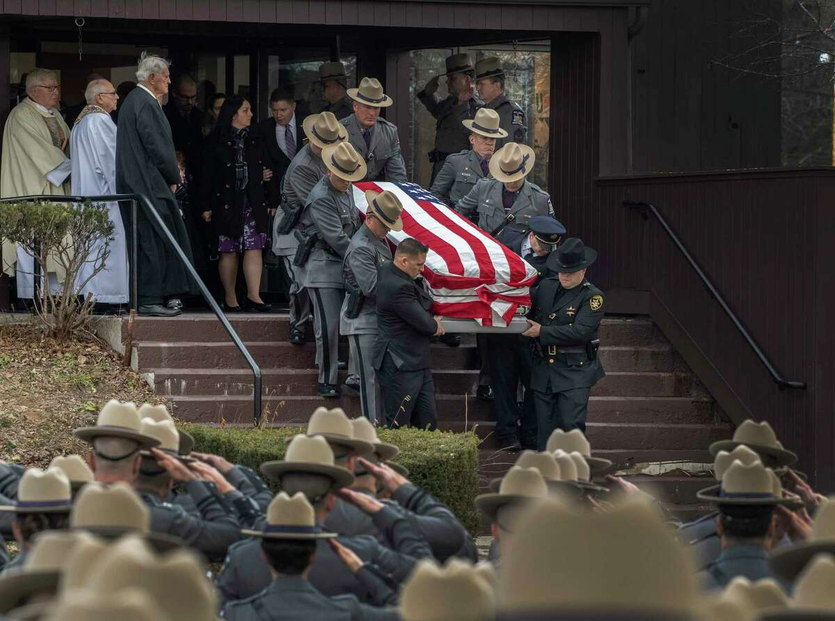 The casket is from St. Gabriel The Archangel Roman Catholic Church after the funeral ceremony of fallen Trooper Jeremy VanNostrand Monday Dec. 3, 2018 in Schenectady, N.Y. (Skip Dickstein/Times Union)