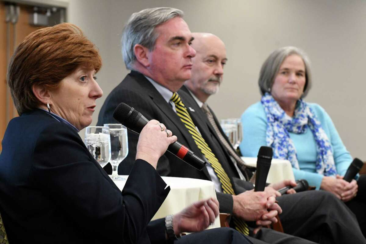 Mayor Kathy Sheehan, left, is joined by mayors Gary McCarthy of Schenectady, Patrick Madden of Troy and Meg Kelly of Saratoga Springs, right, during a forum to discuss the challenges facing their cities and the nation's urban centers on Monday, Dec. 3, 2018, at the Hearst Media Center in Colonie, N.Y. (Will Waldron/Times Union)