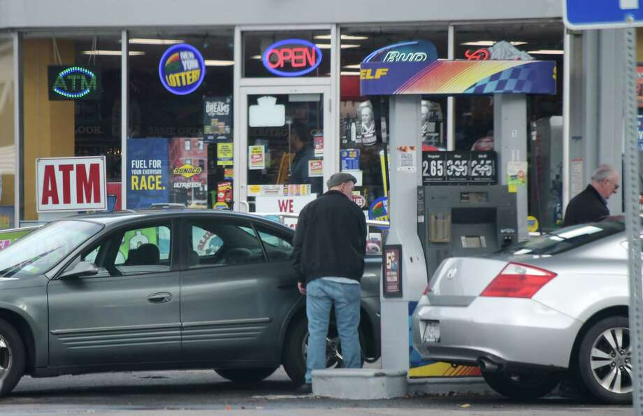People fill their cars with gas at a Sunoco station on Monday, Dec. 3, 2018, in Schenectady, N.Y.   (Paul Buckowski/Times Union) Photo: Paul Buckowski, Albany Times Union / (Paul Buckowski/Times Union)