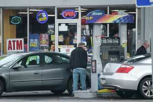 People fill their cars with gas at a Sunoco station on Monday, Dec. 3, 2018, in Schenectady, N.Y.   (Paul Buckowski/Times Union)