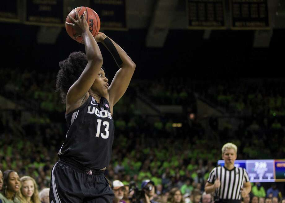UConn freshman Christyn Williams holds the ball during the first half against Notre Dame Sunday in South Bend, Ind. (AP Photo/Robert Franklin) Photo: Robert Franklin / Associated Press / FR17139 AP