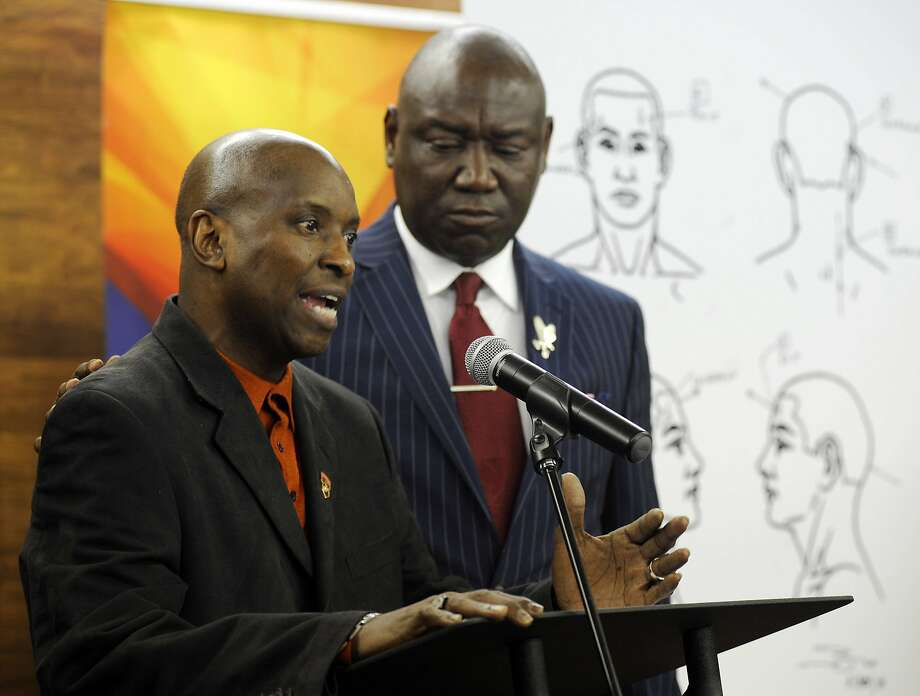 Emantic Bradford Sr. (left) and lawyer Benjamin Crump discuss the fatal shooting of Bradford's son by police. Photo: Jay Reeves / Associated Press