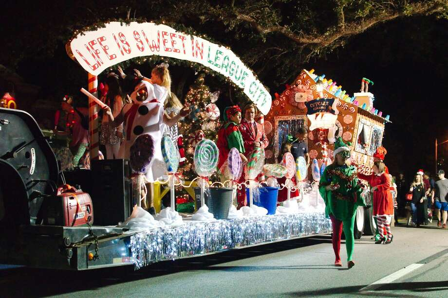 Santa waves to the crowd from the League City Masonic Lodge #1053 float in the Annual Holiday in the Park Parade Saturday, Dec. 1. Photo: Kirk Sides/Staff Photographer