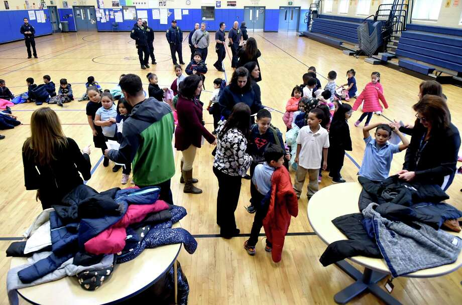 New Haven, Connecticut - Monday, December 3, 2018: 300 winter coats are given out to children in need Monday morning at the Clinton Avenue School in New Haven. The coat drive and giveaway event at the school, in its second year, is sponsored by the Servpro of Meriden and the Connecticut Shoreline and organized by Leshea Schaivone (CQ) of Hamden to honor the memory of her mother Donna Schaivone. Photo: Peter Hvizdak, Hearst Connecticut Media / New Haven Register