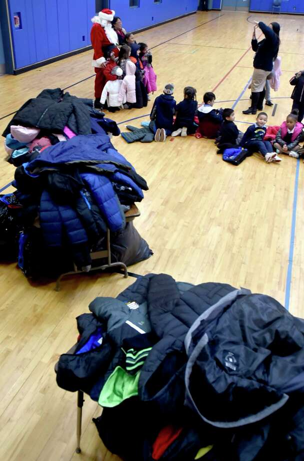 New Haven, Connecticut - Monday, December 3, 2018: Santa Claus visits with children after 300 winter coats  were given out to children in need Monday morning at the Clinton Avenue School in New Haven The coat drive and giveaway event at the school, in its second year, is sponsored by the Servpro of Meriden and the Connecticut Shoreline and organized by Leshea Schaivone (CQ) of Hamden to honor the memory of her mother Donna Schaivone. Photo: Peter Hvizdak, Hearst Connecticut Media / New Haven Register