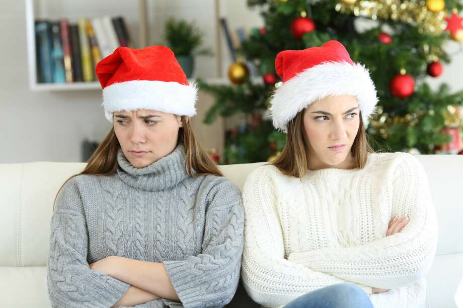 Two family members can't bury the hatchet for the holidays. Photo: AntonioGuillem/Getty Images/iStockphoto