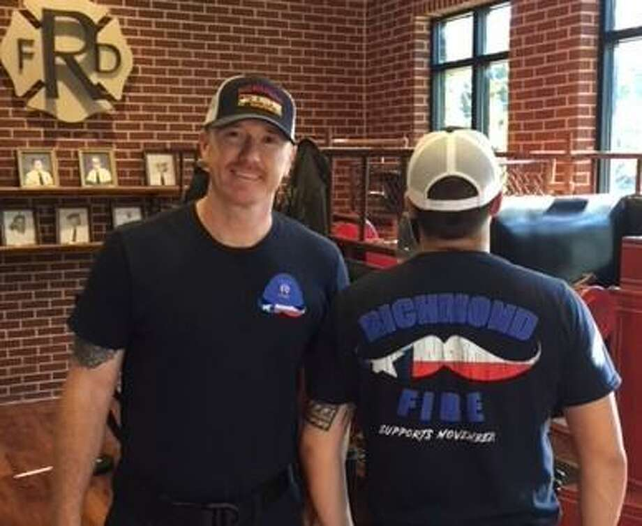 Richmond firefighters Jake Winters, left, and Tony Reeder model T-shirts designed to bring attention in November to Prostate and Testicular Cancer.A new tradition began this November since it is recognized as the month to raise awareness of men's health (Movember) as well as target cancers that generally impact men- prostate and testicular cancers. Photo: Richmond Fire Department / Richmond Fire Department