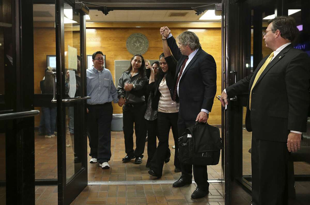 The San Antonio Four, from left, Kristie Mayhugh, Anna Vasquez, Elizabeth Ramirez, Cassandra Rivera. walk out of Bexar County Jail with their attorney Mike Ware in November 2013. Mayhugh, Ramirez and Rivera were released from jail after the Bexar County 175th District Court set them free on personal bonds. The three women, along with Vazquez, paroled last year, were convicted on child sexual assault charges in the late 1990s. Known as the San Antonio 4, they were exonerated in 2018 after one of the alleged victims testified she lied about the assault and it was shown forensic science did not support the claims of rape. A state district judge on Friday signed an order expunging their records.