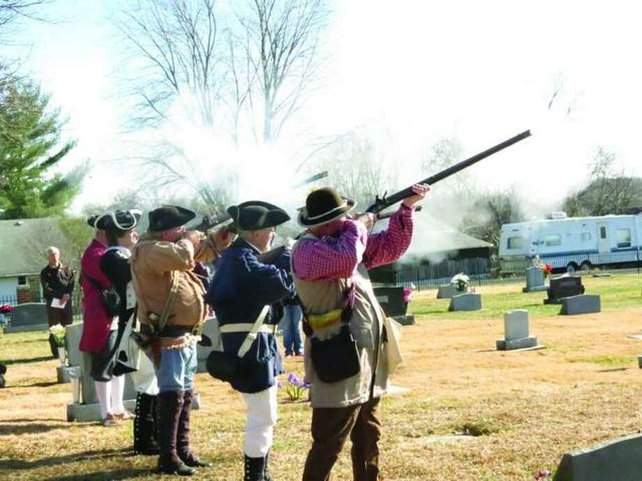 Members of the Gen. George Rogers Clark (GGRC) Chapter of The Sons of the American Revolution color guard fire their weapons in a salute to the fallen at a previous Wreaths Across America Ceremony. This year's wreath-laying ceremony is at Glen Carbon Village Cemetery at West Guy and Center streets, beginning at 11 a.m. on Saturday, Dec. 15. Photo: For The Intelligencer