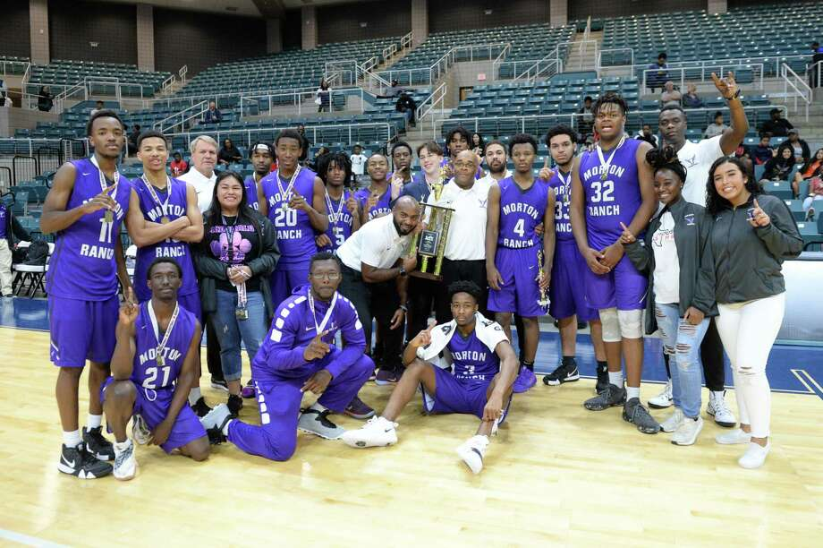 The Morton Ranch Mavericks celebrate their first place finish in the Gold Bracket of the ConocoPhillips Katy ISD Classic on Saturday, Dec. 1, at the Leonard Merrell Center in Katy. Photo: Craig Moseley, Houston Chronicle / Staff Photographer / ©2018 Houston Chronicle