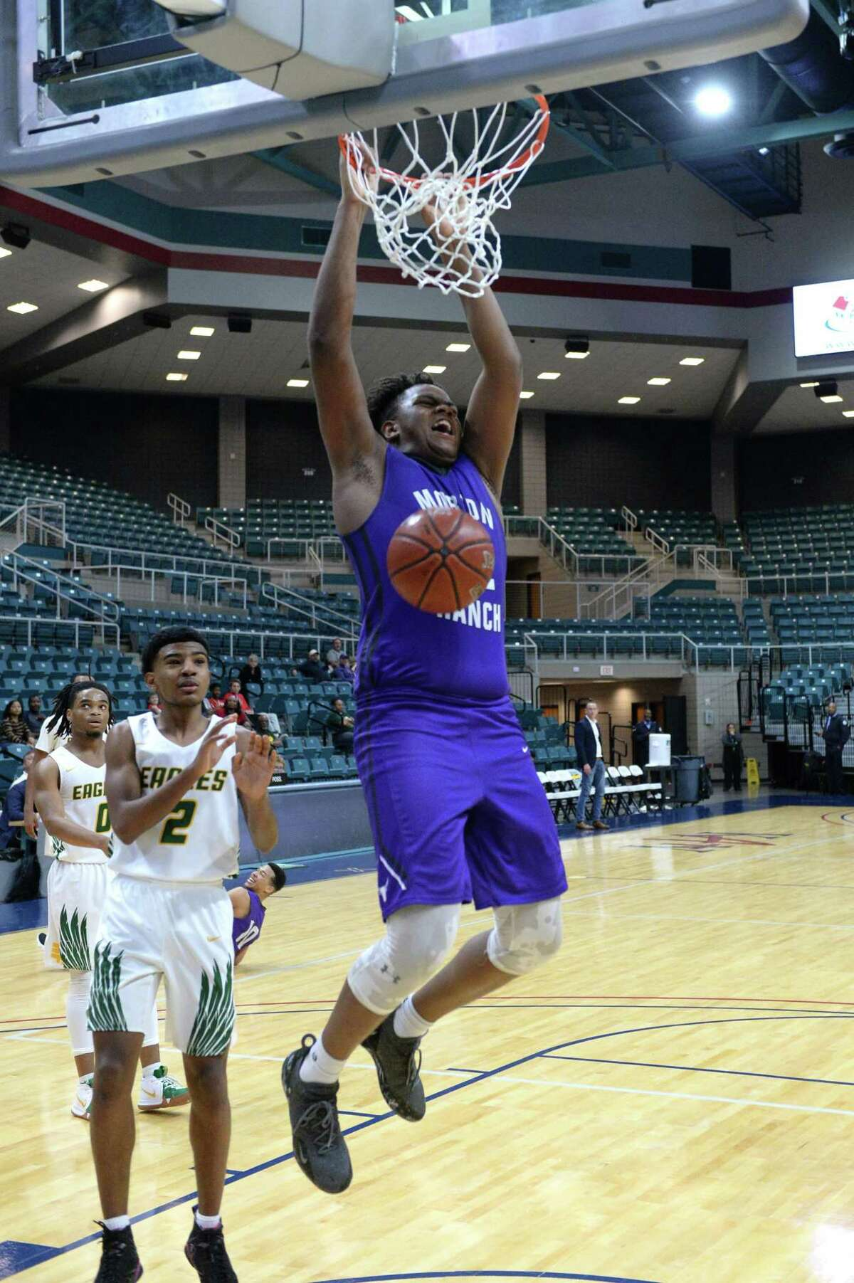 Eddie Lampkin (32) of Morton Ranch completes a slam-dunk during the second half of the Gold Bracket championship game between the Morton Ranch Mavericks and the Klein Forest Golden Eagles in the ConocoPhillips Katy ISD Classic on Saturday December 1, 2018 at the Leonard Merrell Center, Katy, TX.