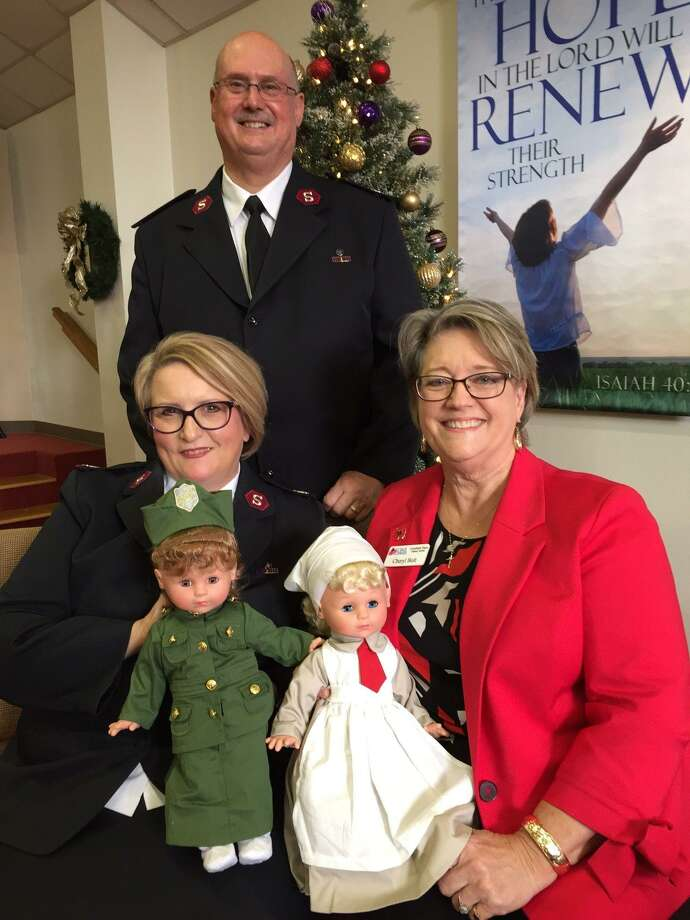 Pictured are Majors Don and Helene Wildish with The Salvation Army with Cheryl Bolt, Coushatti Trace DAR Regent.  The Coushattii Trace DAR Chapter donated two dolls in World War I period clothing for Sunday's Christmas Doll and Bear Tea's silent auction. The dolls were created for the 100th anniversary of the end of World War I brought $300 in the silent auction. Photo: Courtesy Photo