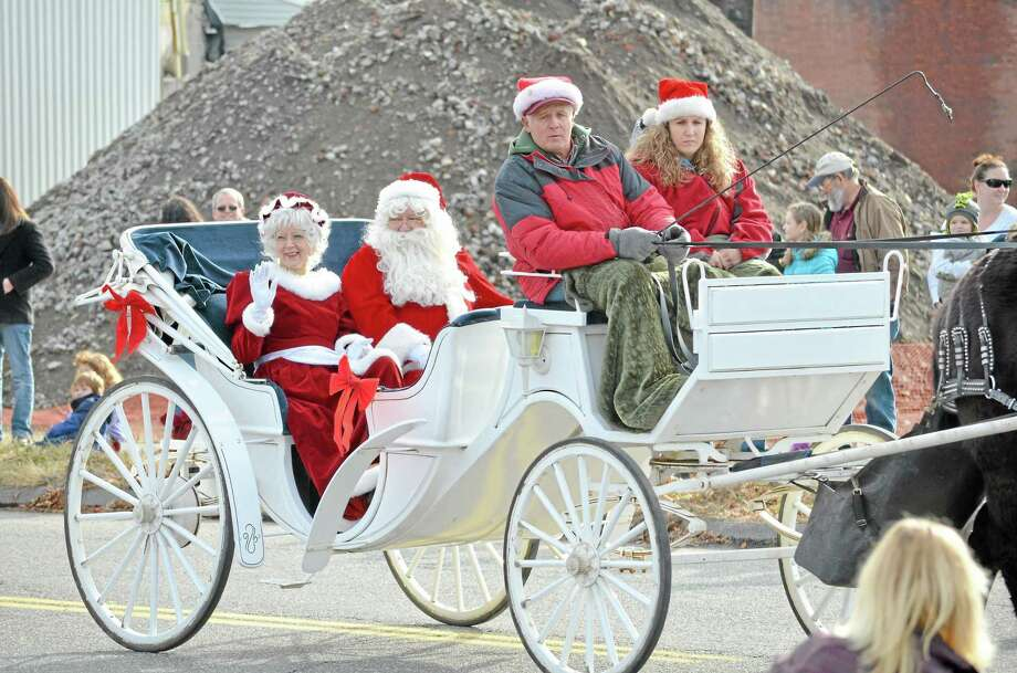 Santa and Mrs. Claus return to Torrington on Sunday, Dec. 9 for the annual Christmas Village parade and season opening. Photo: File Photo / Hearst Connecticut Media