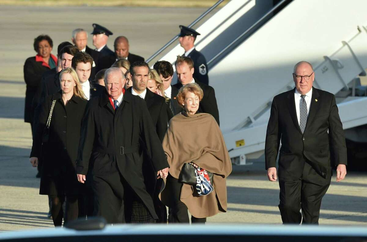 Former White House Chief of Staff, James Baker (front L) walks on the tarmac after getting off the plane carrying former US President George H.W. Bush at Joint Base Andrews, Maryland, on December 3, 2018. (Photo by Nicholas Kamm / AFP)NICHOLAS KAMM/AFP/Getty Images