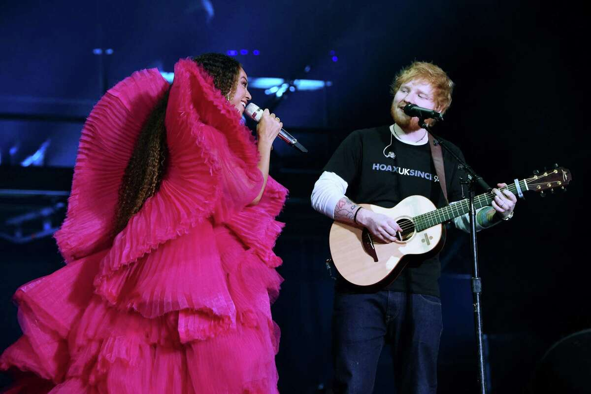 The Houston-native singer wore a sculptural fuchsia tulle gown by the London-based Ashia Studio. Here, she performs with Ed Sheeran.