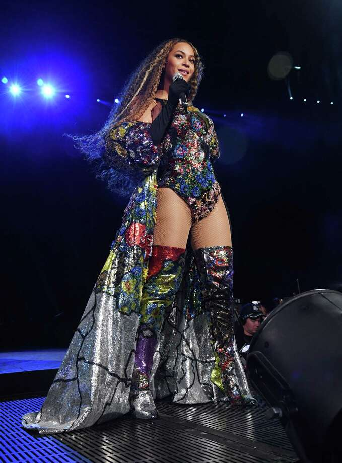 Beyoncé at the Global Citizen Festival: Mandela 100 in Johannesburg, South Africa. Here she wore a sequined bodysuit, balloon-sleeved coat that represents all the African nations designed by Mary Katrantzou. Photo: (Photo By Kevin Mazur/Getty Images For Global Citizen Festival: Mandela 100), Getty Images For Global Citizen / 2018 Kevin Mazur