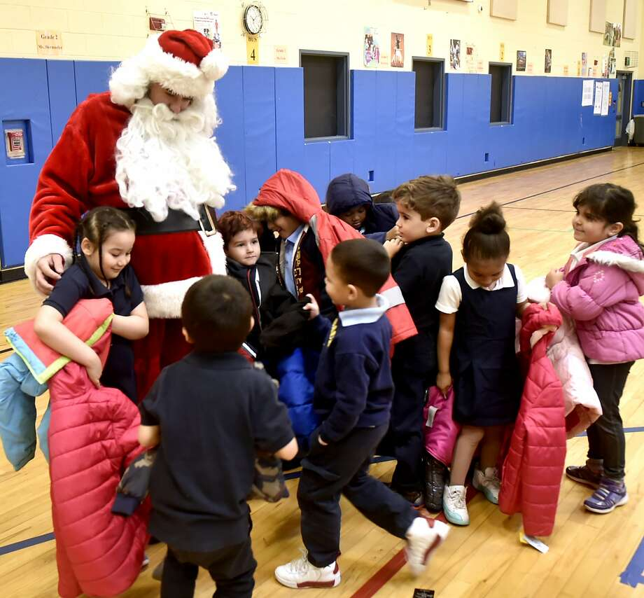 New Haven, Connecticut - Monday, December 3, 2018: Santa Claus visits with children after 300 winter coats  were given out to children in need Monday morning at the Clinton Avenue School in New Haven The coat drive and giveaway event at the school, in its second year, is sponsored by the Servpro of Meriden and the Connecticut Shoreline and organized by Leshea Schaivone (CQ) of Hamden to honor the memory of her mother Donna Schaivone. Photo: Peter Hvizdak, Hearst Connecticut Media