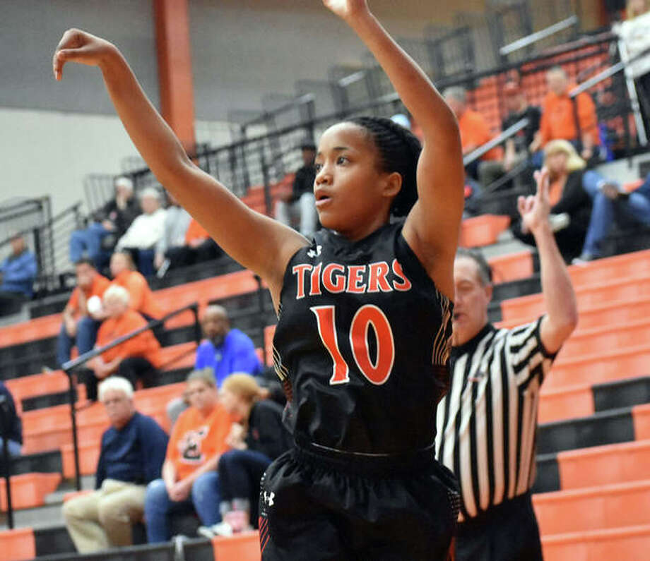 Edwardsville guard Jaylen Townsend watches her 3-point shot swish through the net during the first half against Highland on Saturday. Photo: Matt Kamp/Intelligencer