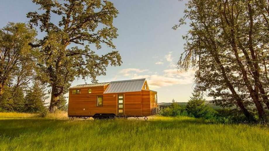 A 397-square-foot tiny house on 80 acres is for sale in Eugene, OR, for $695,000. The home was custom-designed with a cleverly devised modern interior. Photo: Realtor.com