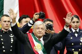 Mexico's new President Andres Manuel Lopez Obrador greets the crowd at the end of his inaugural ceremony at the National Congress in Mexico City, Saturday, Dec. 1, 2018. Mexicans are getting more than just a new president Saturday. The inauguration of Lopez Obrador will mark a turning point in one of the world's most radical experiments in opening markets and privatization. (AP Photo/Eduardo Verdugo)