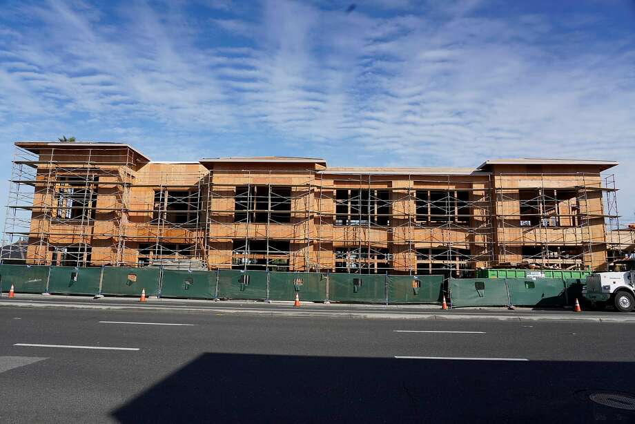 There's wide agreement that housing near transit, like this development in San Carlos, is needed. But the route to providing more is controversial. Photo: Lea Suzuki / The Chronicle