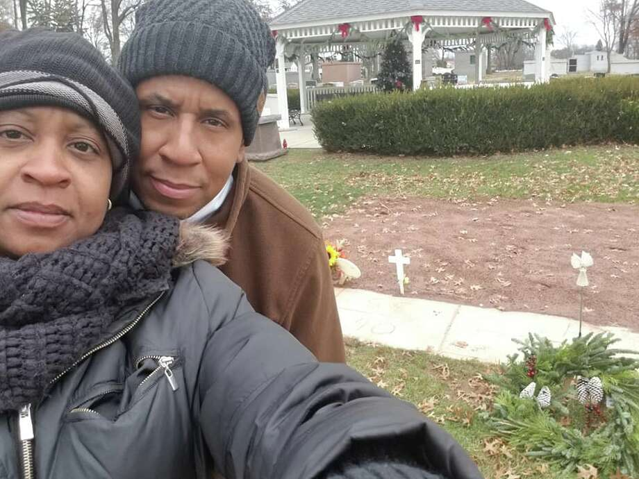 Yvonne Ketter-Walls and Thomas Walls visit the grave of their son, Raolik Walls, in Colonia, N.J. (provided)