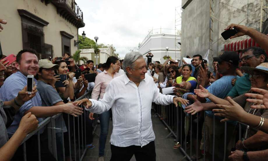 Andres Manuel Lopez Obrador, who took office as Mexico's new president Saturday, greets supporters Sept. 16 as he kicks off a nationwide tour after his election in Mazatlan, Mexico. His election marks an opportunity for Texas to export green-energy expertise to Mexico. Photo: Eduardo Verdugo /Associated Press / Copyright 2018 The Associated Press. All rights reserved.