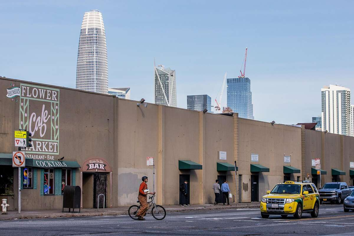 Tall buildings that make of San Francisco's skyline hang over the Flower Market on 6ht and Brannan streets in the South of Market district of San Francisco, Calif. Wednesday, Nov. 28, 2018.
