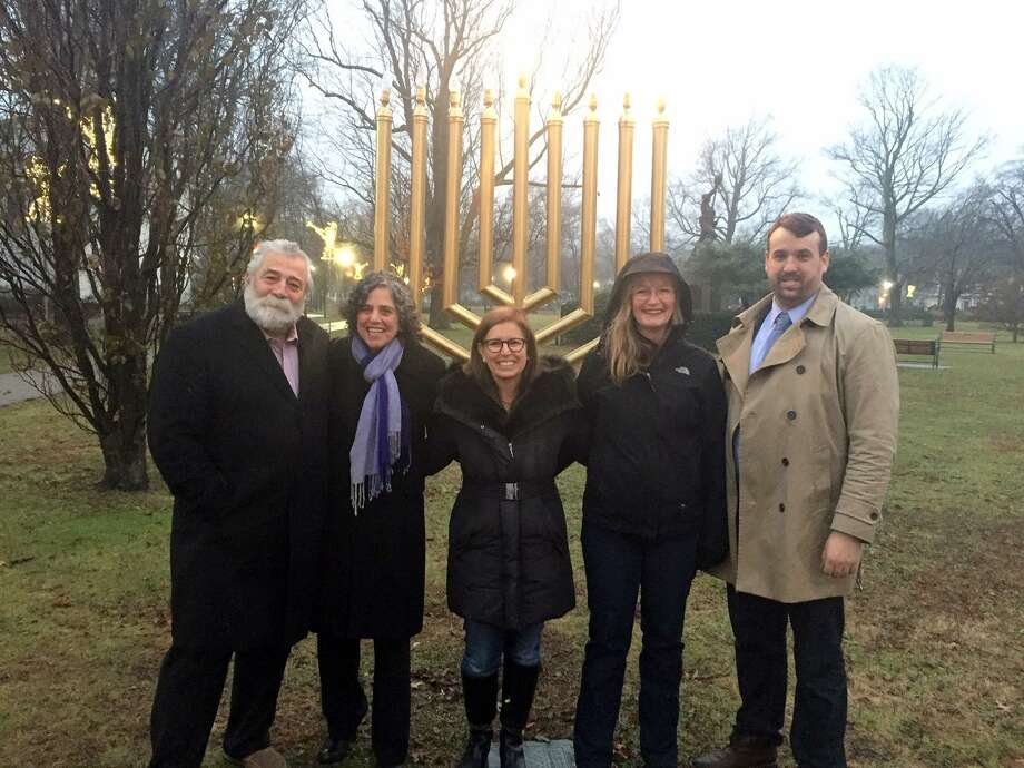 Rabbi Rona Shapiro, second from left, with, from left, state Rep. Charles Ferraro, state Sen. Gayle Slossberg, Mayor Nancy Rossi and Councilman Aaron Charney, D-3. Photo: Contributed Photo / Ruth G. Torres