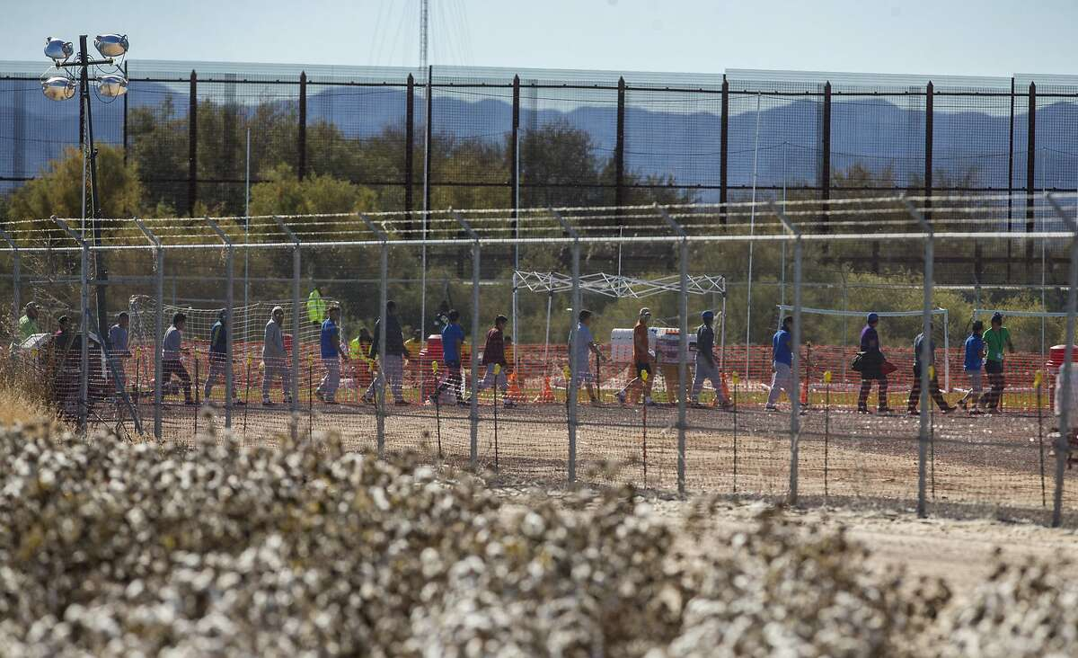 In this Nov. 15, 2018 photo provided by Ivan Pierre Aguirre, migrant teens are led in a line inside the Tornillo detention camp holding more than 2,300 migrant teens in Tornillo, Texas.