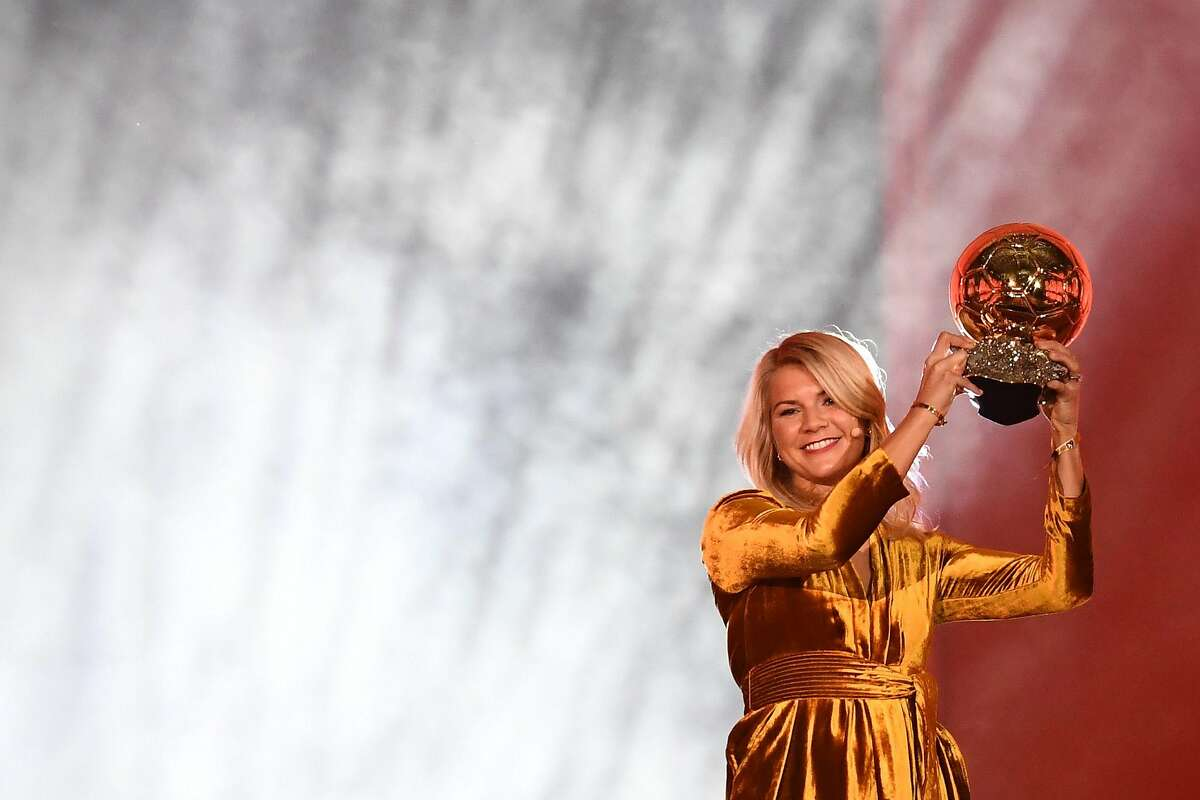Olympique Lyonnais' Norwegian forward Ada Hegerberg brandishes her trophy after receiving the 2018 FIFA Women's Ballon d'Or award for best player of the year during the 2018 FIFA Ballon d'Or award ceremony at the Grand Palais in Paris on December 3, 2018. - The winner of the 2018 Ballon d'Or will be revealed at a glittering ceremony in Paris on December 3 evening, with Croatia's Luka Modric and a host of French World Cup winners all hoping to finally end the 10-year duopoly of Cristiano Ronaldo and Lionel Messi. (Photo by FRANCK FIFE / AFP)FRANCK FIFE/AFP/Getty Images