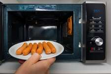 Hot dogs Why you shouldn't reheat them in a microwave: Cancer-causing chemicals used in processing hot dog meat are activated by microwaving. Why you not listen to the above: In moderation, they should pose no health risk.