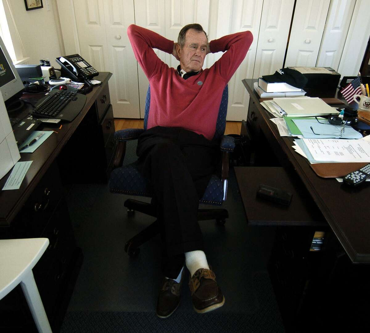 Former U.S. President George Herbert Walker Bush sits in his private office at the Walker Point Estate in Kennebunkport, Maine, in 2004.