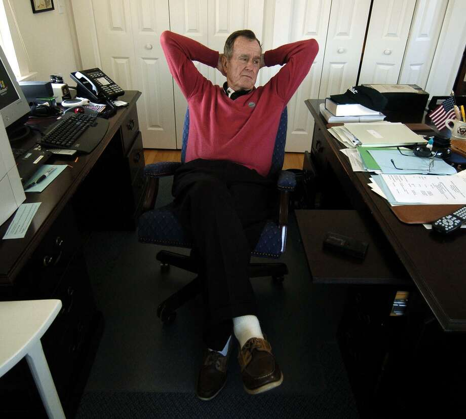 Former U.S. President George Herbert Walker Bush sits in his private office at the Walker Point Estate in Kennebunkport, Maine, in 2004. Photo: Karl Stolleis / Houston Chronicle / © Houston Chronicle
