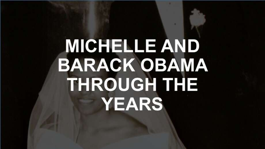 Click through the gallery to see Michelle and Barack Obama through the years. Photo: AP Photo/Obama For America