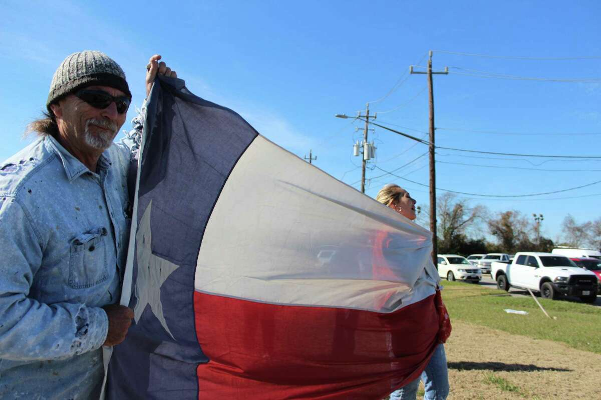 PHOTOS: Bush honored around the nationJosh and Nicole Crippen held onto a large Texas flag as they pay tribute to former President George H.W. Bush at Ellington Airport.>>>Keep clicking to see how newspaper around the country honored the late former president...
