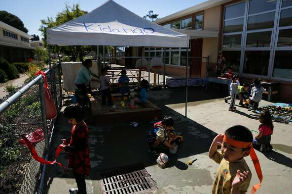 Students play during a Kidango preschool session at Corvallis Elementary School in San Lorenzo, California, on Friday, June 12, 2015. Kidango operates a year-round preschool at Corvallis Elementary. California lawmakers will vote Monday on a state budget that includes expanding subsidized preschool.