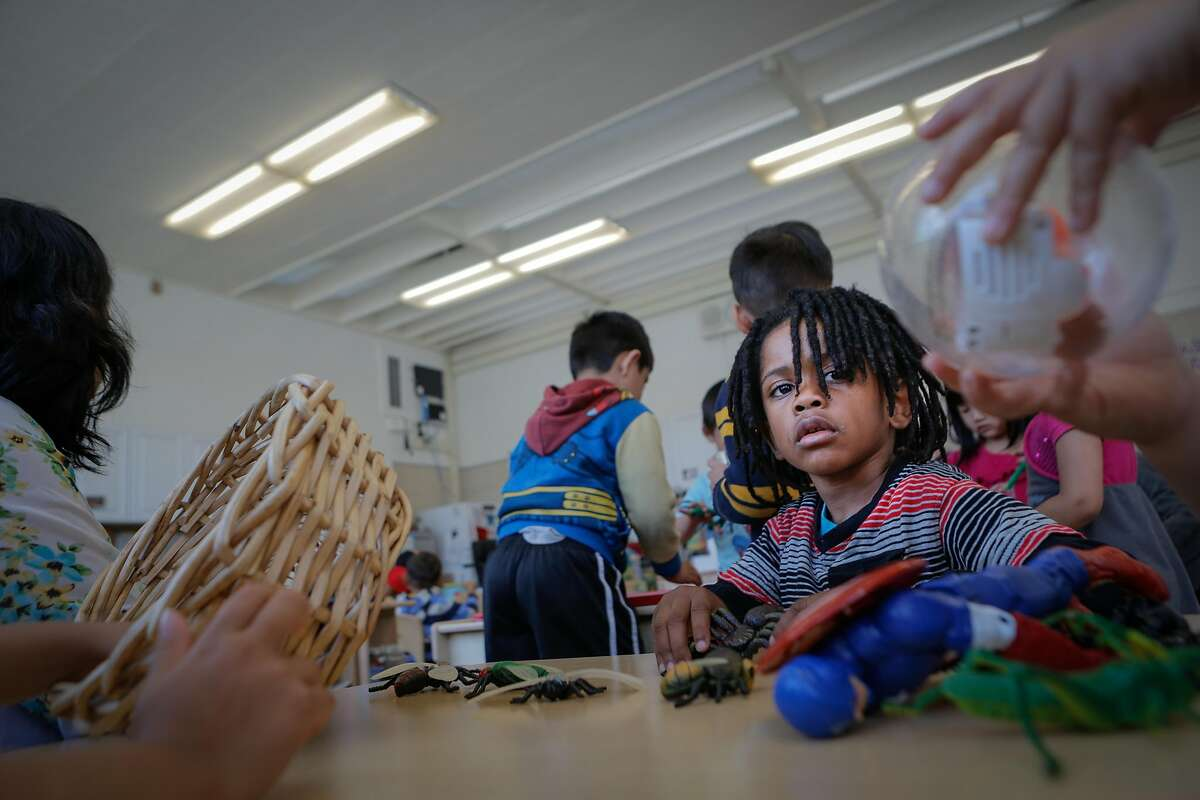 Dewayne Page Little Jr. watches a classmate play with a toy during a Kidango preschool session at Corvallis Elementary School in San Lorenzo, California, on Friday, June 12, 2015. Kidango operates a year-round preschool at Corvallis Elementary. California lawmakers will vote Monday on a state budget that includes expanding subsidized preschool.