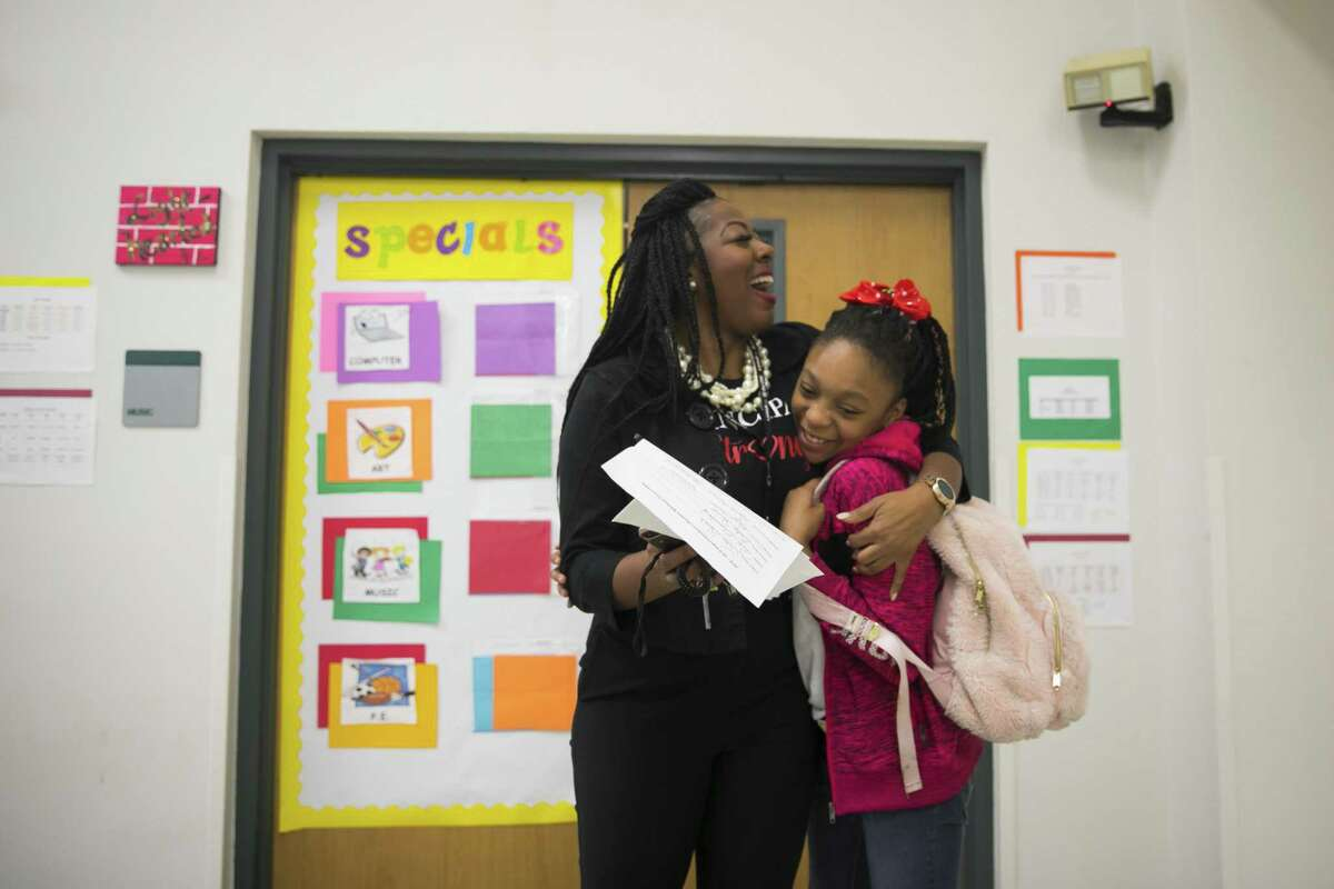 Pink Elementary Principal Tiffany Foster welcomes Jada Spears to school on October 25, 2018. Foster greets students as they arrive and then checks in with every classroom between the first tardy bell and morning announcements each morning.