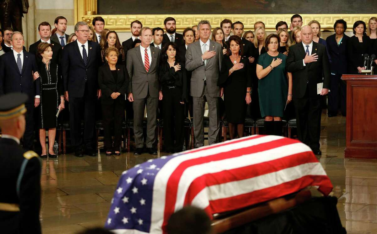 Members of the Bush family including George W. Jeb, and Neil stand and watch after the pallbearers delivered the casket of President George H.W. Bush during his State Funeral at the United States Capitol Rotunda, Monday, Dec. 3, 2018, in Washington. Bush will lie in state in the Rotunda until Wednesday morning.>>>Keep clicking to see how the late president was honored in front page papers across the nation...