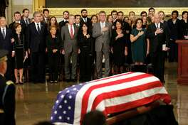 Members of the Bush family including George W. Jeb, and Neil stand and watch after the pallbearers delivered the casket of President George H.W. Bush during his State Funeral at the United States Capitol Rotunda, Monday, Dec. 3, 2018, in Washington. Bush will lie in state in the Rotunda until Wednesday morning.