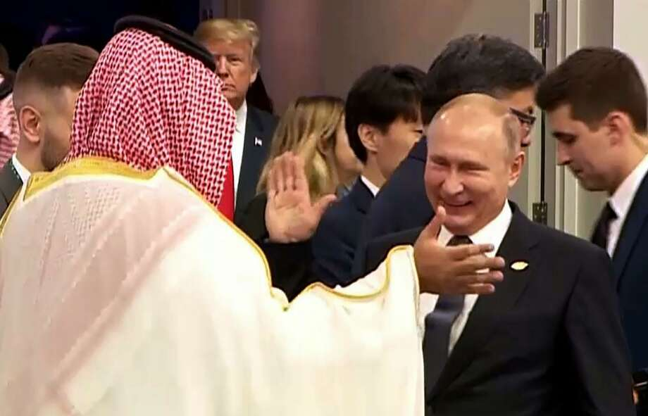Russia's President Vladimir Putin (C) and Saudi Arabia's Crown Prince Mohammed bin Salman struck a deal the G-20 meeting to extend the OPEC+ production cuts. Photo: HO, Handout / AFP/Getty Images / AFP or licensors