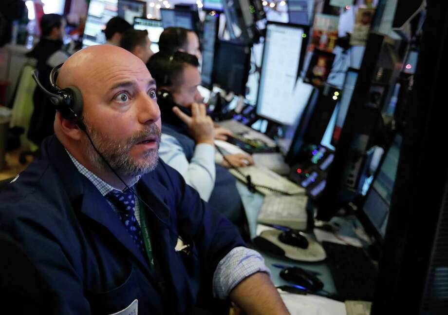 Trader Vincent Napolitano works on the floor of the New York Stock Exchange, Monday, Dec. 3, 2018. Stocks are opening sharply higher on Wall Street, following gains in overseas markets after the U.S. and China struck a 90-day truce in their trade dispute. (AP Photo/Richard Drew) Photo: Richard Drew / Copyright 2018 The Associated Press. All rights reserved