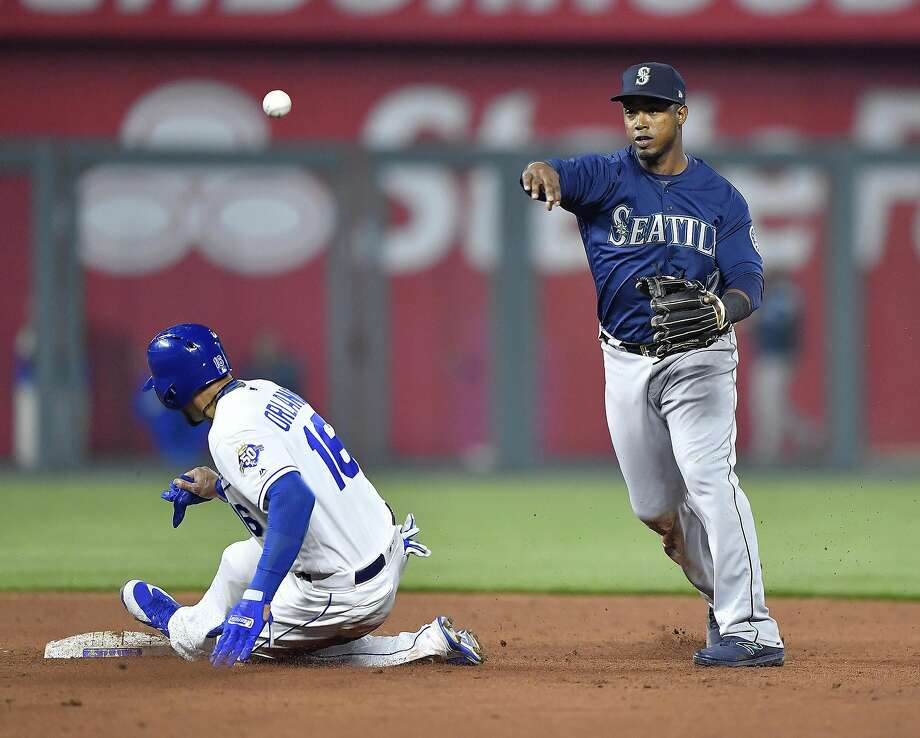 Seattle Mariners shortstop Jean Segura, right, forces out the Kansas City Royals' Paulo Orlando at second and completes a double play on April 10, 2018, at Kauffman Stadium in Kansas City, Mo. If the San Diego Padres are able to complete a deal for Segura, it could spell the end of Wil Myers' tenure with the Friars. (John Sleezer/Kansas City Star/TNS) Photo: John Sleezer, TNS