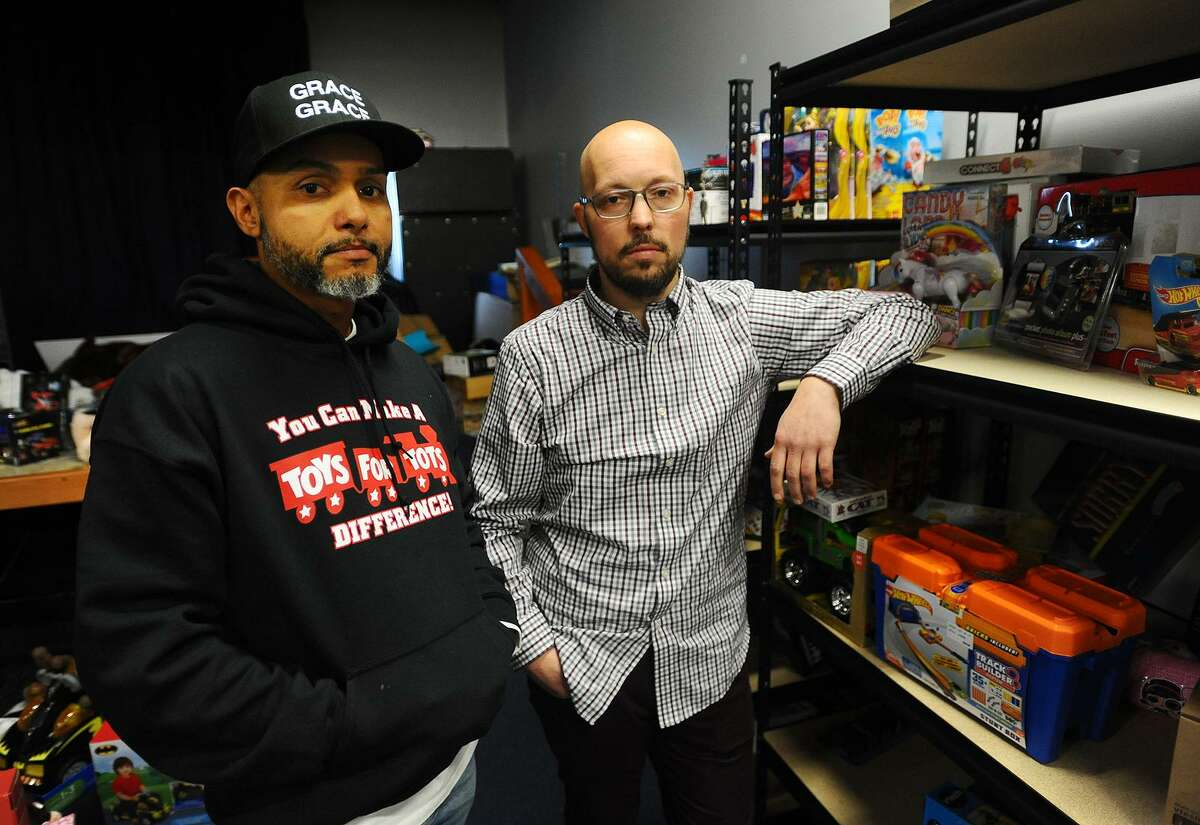 Jerry Martinez, left, and Pastor Eric Torres with the meager remains of the toys they have collected for their Toys for Tots campaign following Saturday's robbery of over eight hundred toys from four storage pods outside Greater Bridgeport Christian Fellowship Church at 180 Boston Avenue in Bridgeport, Conn. on Monday, December 3, 2018.