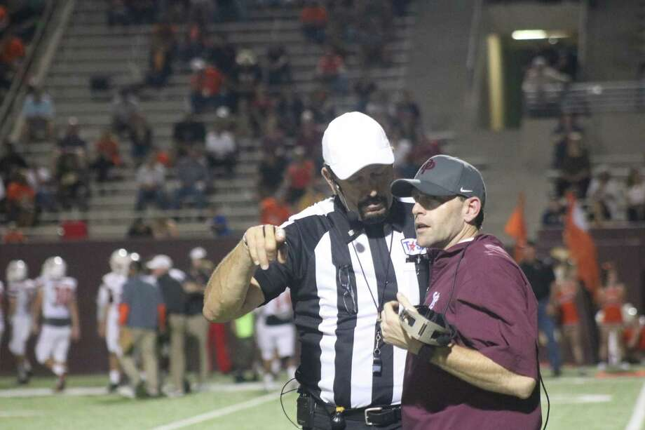 A referee explains a call to Deer Park head coach Austin Flynn during a district game this season. It was a case of so close, yet so far for Flynn's first season at the Deer helm. Photo: Robert Avery